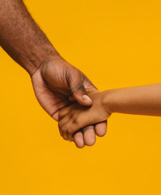 Father and child hands fathers