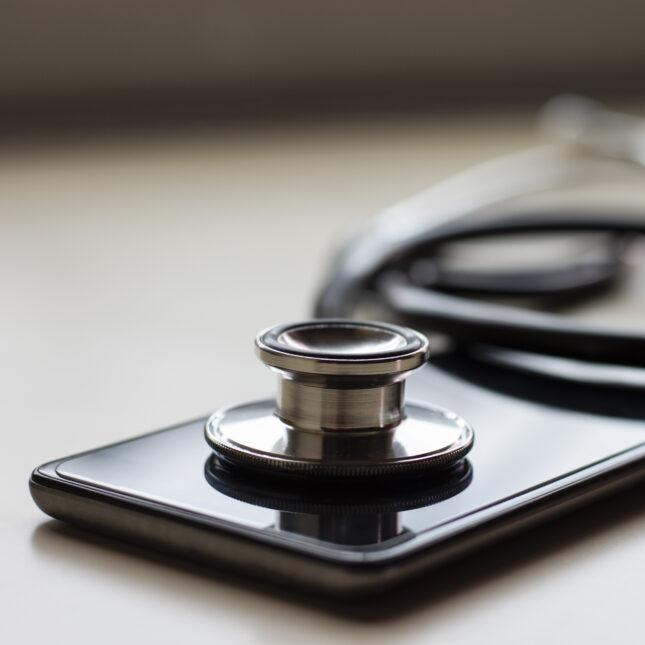 Telemedicine - phone and stethoscope telehealth
