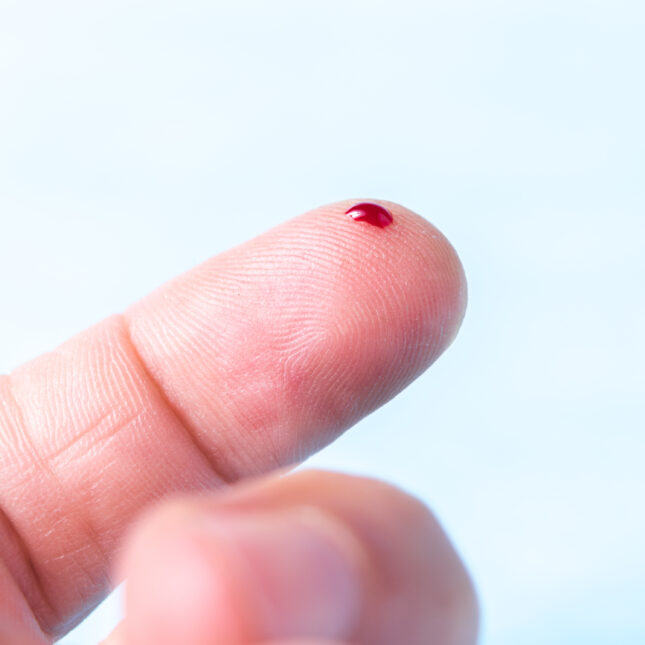 drop of blood on the finger