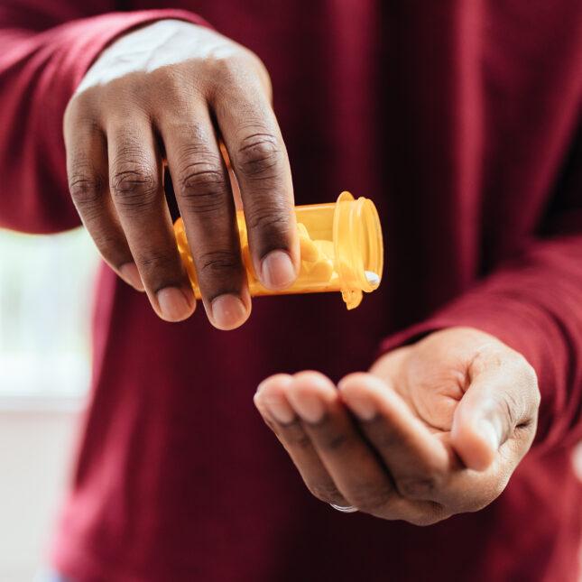 pouring pills prescription medicine
