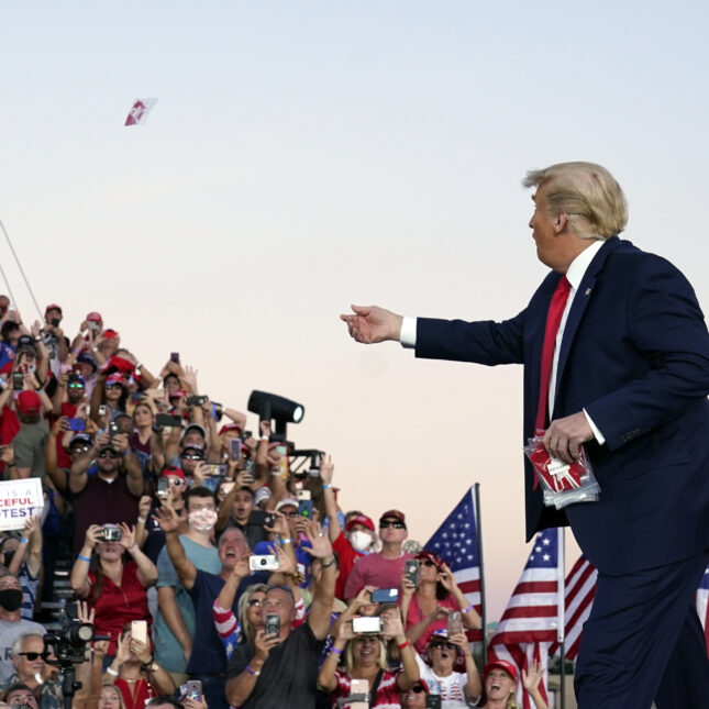 Trump throws a mask to the crowd