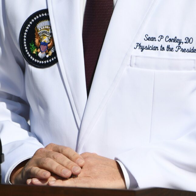 White House physician Sean Conley in a white coat