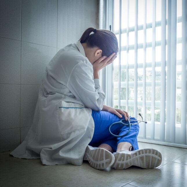 doctor near window