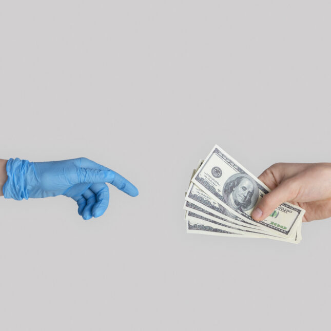 handing doc money