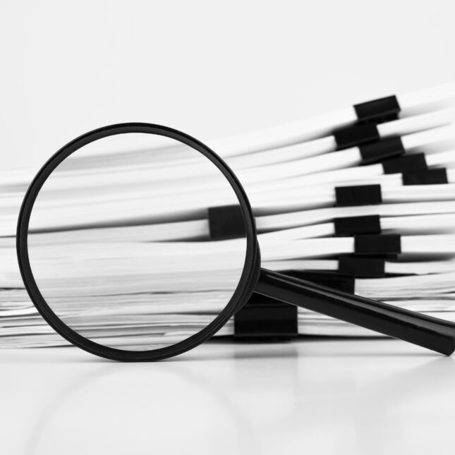 magnifying glass w/ reports