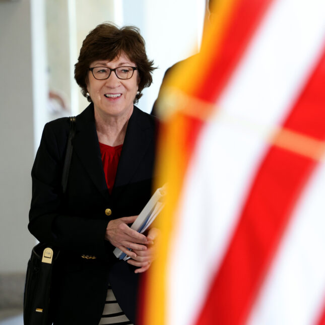 Sen. Susan Collins w/ flag